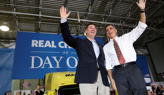 Republican presidential candidate, former Massachusetts Gov. Mitt Romney and Virginia Republican Senate candidate George Allen wave to supporters during a campaign at Integrity Windows in Roanoke, Va., Thursday, Nov. 1, 2012. (AP Photo/Charles Dharapak)