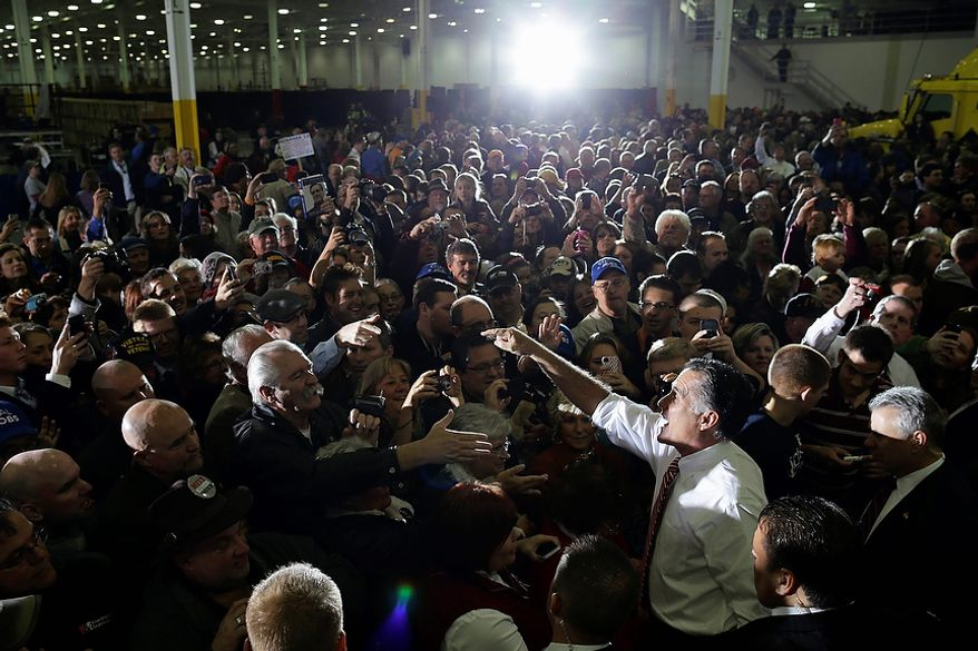Republican presidential candidate, former Massachusetts Gov. Mitt Romney greets supporters as he campaigns at Integrity Windows in Roanoke, Va., Thursday, Nov. 1, 2012. (AP Photo/Charles Dharapak)