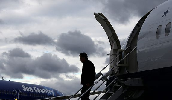 A silhouetted Republican presidential candidate, former Massachusetts Gov. Mitt Romney steps off his plane at Roanoke Regional Woodrum Field in Roanoke, Va., Thursday, Nov. 1, 2012, for campaign events. (AP Photo/Charles Dharapak)