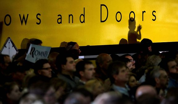 The shadow of a child applauding is cast against a truck as Republican presidential candidate, former Massachusetts Gov. Mitt Romney speaks at a campaign event at Integrity Windows in Roanoke, Va., Thursday, Nov. 1, 2012. (AP Photo/David Goldman)