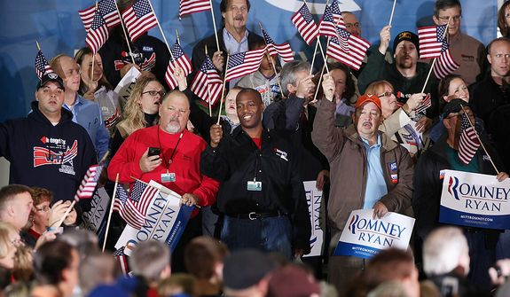 Supporters cheer as they wait to hear Republican presidential candidate, former Massachusetts Gov. Mitt Romney speak at a campaign event at a window and door factory, Thursday, Nov. 1, 2012, in Roanoke, Va. (AP Photo/The Roanoke Times, Jeanna Duerscherl)