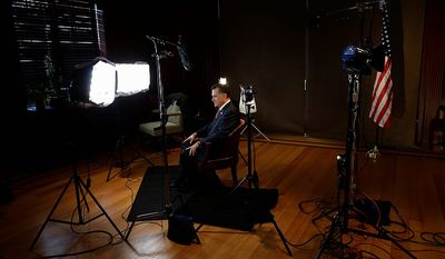 Republican presidential candidate and former Massachusetts Gov. Mitt Romney gets ready to film a video message for Get Out the Vote (GOTV) after he campaigned at Meadow Event Park in Richmond, Va., Thursday, Nov. 1, 2012. (AP Photo/Charles Dharapak)