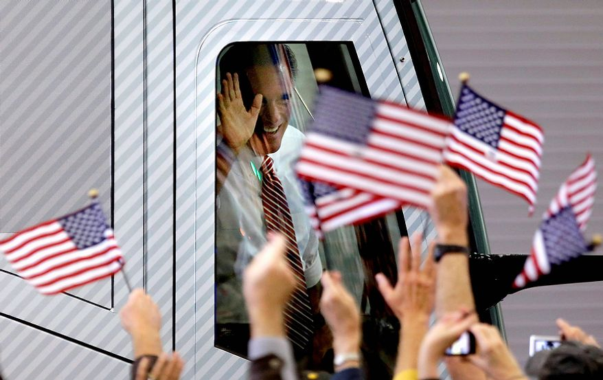 Supporters wave American flags and Republican presidential candidate, former Massachusetts Gov. Mitt Romney waves as he arrives in his campaign bus for a campaign event at Meadow Event Park Thursday, Nov. 1, 2012, in Doswell, Va. (AP Photo/David Goldman)