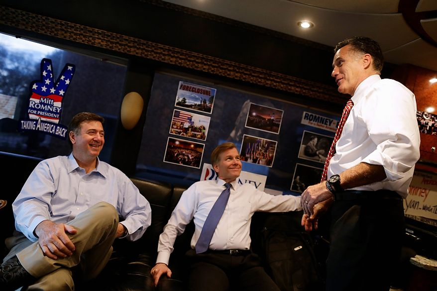 Republican presidential candidate and former Massachusetts Gov. Mitt Romney, right, talks with Virginia Republican Senate candidate George Allen, left, and Virginia Gov. Bob McDonnell, center, after a campaign event at Meadow Event Park, in Richmond, Va., Thursday, Nov. 1, 2012. (AP Photo/Charles Dharapak)