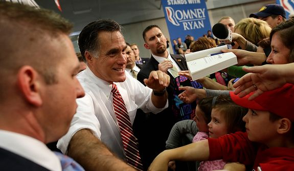 Republican presidential candidate, former Massachusetts Gov. Mitt Romney greets supporters as he campaigns at Meadow Event Park, in Richmond, Va., Thursday, Nov. 1, 2012. (AP Photo/Charles Dharapak)