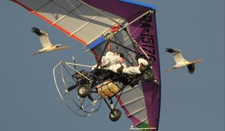 Russian President Vladimir Putin flies in a motorized hang glider alongside two Siberian white cranes over Russia's Yamal Peninsula on Wednesday, Sept. 5, 2012. (AP Photo/RIA-Novosti, Alexei Druzhinin, Presidential Press Service)