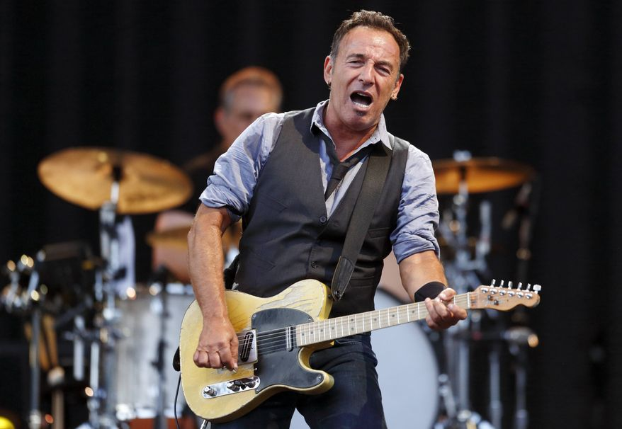 ** FILE ** Bruce Springsteen performs at Fenway Park in Boston on Tuesday, Aug. 14, 2012. (AP Photo/Michael Dwyer)