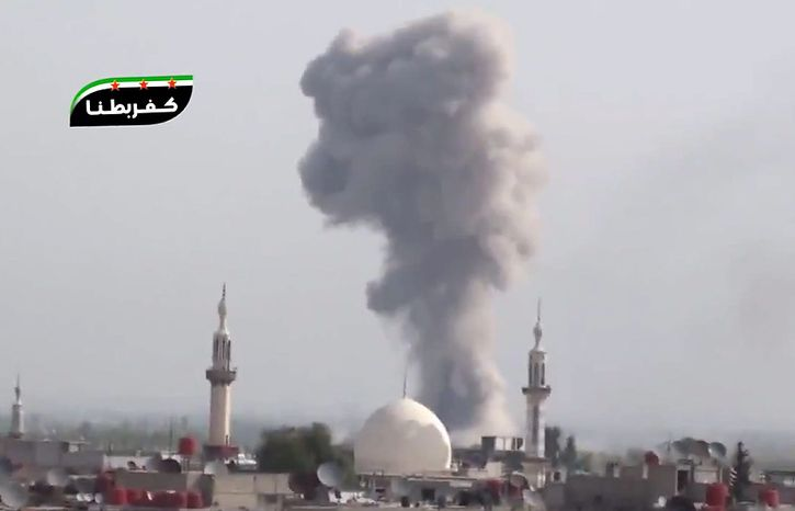 This image taken from video obtained from Shaam News Network, which has been authenticated based on its contents and other AP reporting, shows smoke rising from the city following heavy bombing from military warplanes, in a suburb of Damascus, Syria, on wednesday, Oct. 31, 2012. Syrian warplanes pounded opposition strongholds around Damascus and in the north Wednesday, as President Bashar Assad's forces intensified airstrikes against rebels seeking to topple him, activists said. (AP Photo/Shaam News Network via AP video)