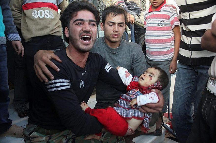 In this picture taken on Tuesday, Oct. 30, 2012, a citizen journalism image provided by Edlib News Network, ENN, which has been authenticated based on its contents and other AP reporting, a Syrian man mourns as he holds the body of a young girl, who was killed in shelling of the Syrian forces loyal to Syrian President Bashar Assad, at Kfar Batikh village, in Idlib province, northern Syria. Syrian warplanes fired missiles at opposition strongholds around Damascus and in the north on Wednesday as Turkey, a key backer of the anti-regime rebels, appeared to distance itself from an earlier call to impose a no-fly zone. (AP Photo/Idlib News Network ENN)