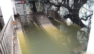 This Oct. 30, 2012, photo provided by New York's Metropolitan Transportation Authority (MTA) shows a flooded escalator in the South Ferry station of the No. 1 subway line, in lower Manhattan, after Superstorm Sandy passed through New York. (AP Photo/Metropolitan Transportation Authority)