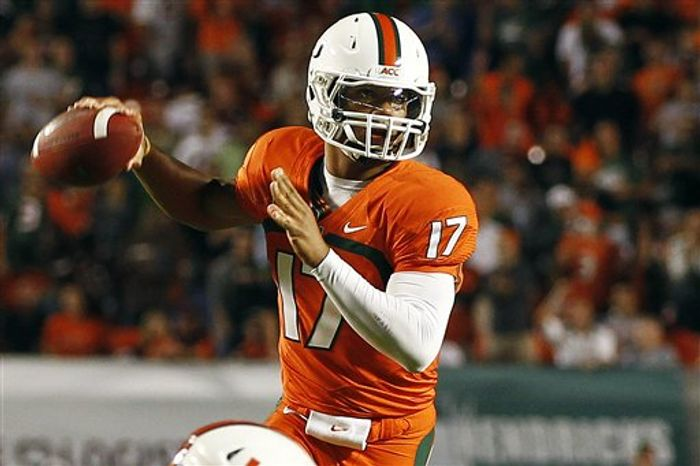 Miami quarterback Stephen Morris passes against Virginia Tech during the first half of their NCAA football game in Miami, Thursday, Nov. 1, 2012. (AP Photo/J Pat Carter)