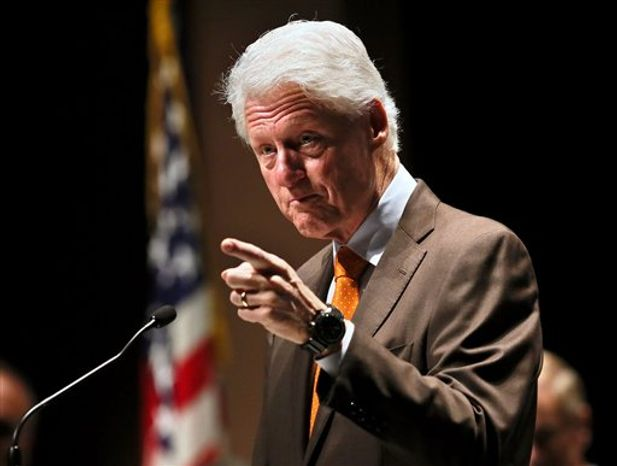 ** FILE ** Former President Bill Clinton addresses the crowd during a rally for President Barack Obama at Palm Beach State College Friday, Nov. 2, 2012, in Lake Worth, Fla. (AP Photo/Palm Beach Post, Lannis Waters)