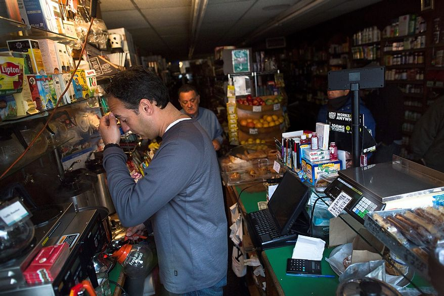 Manager Dean Pappas, 40, of Long Island, pauses as he makes coffee at The Open Pantry store on 12th Street that remains without power due to Superstorm Sandy, Friday, Nov. 2, 2012, in New York. In Manhattan, where 226,000 buildings, homes and business remain without power, Consolidated Edison says they should have service restored by Saturday.  (AP Photo/ John Minchillo)