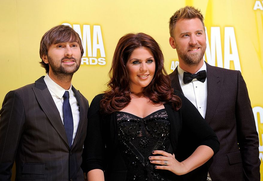 Musical group Lady Antebellum, from left, Dave Haywood, Hillary Scott and Charles Kelley, arrive at the 46th Annual Country Music Awards at the Bridgestone Arena on Thursday, Nov. 1, 2012, in Nashville, Tenn. (Photo by Chris Pizzello/Invision/AP)