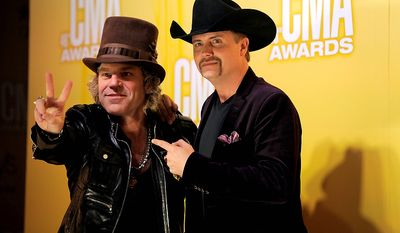Big Kenny, left, and John Rich, of musical duo Big & Rich, arrive at the 46th Annual Country Music Awards at the Bridgestone Arena on Thursday, Nov. 1, 2012, in Nashville, Tenn. (Photo by Chris Pizzello/Invision/AP)