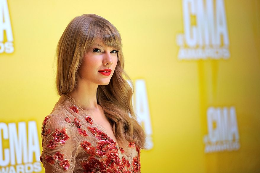 Taylor Swift arrives at the 46th Annual Country Music Awards at the Bridgestone Arena on Thursday, Nov. 1, 2012, in Nashville, Tenn. (Photo by Chris Pizzello/Invision/AP)