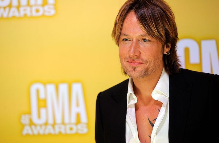 Keith Urban arrives at the 46th Annual Country Music Awards at the Bridgestone Arena on Thursday, Nov. 1, 2012, in Nashville, Tenn. (Photo by Chris Pizzello/Invision/AP)