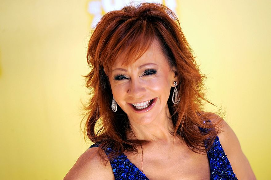 Reba McEntire arrives at the 46th Annual Country Music Awards at the Bridgestone Arena on Thursday, Nov. 1, 2012, in Nashville, Tenn. (Photo by Chris Pizzello/Invision/AP)