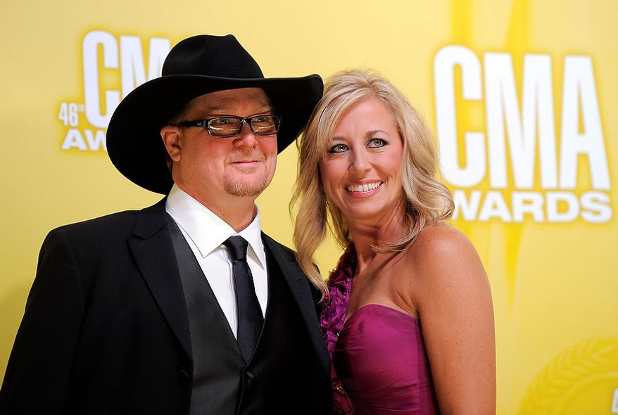 Tracy Lawrence, left, and Becca Lawrence arrive at the 46th Annual Country Music Awards at the Bridgestone Arena on Thursday, Nov. 1, 2012, in Nashville, Tenn. (Photo by Chris Pizzello/Invision/AP)