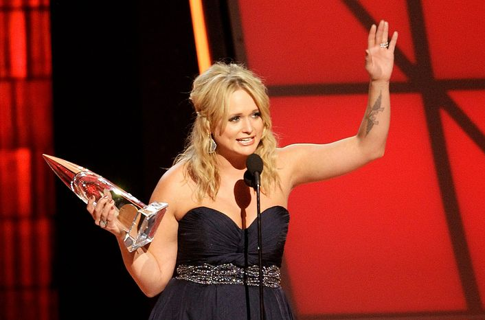 Miranda Lambert accepts the award for female vocalist of the year at the 46th Annual Country Music Awards at the Bridgestone Arena on Thursday, Nov. 1, 2012, in Nashville, Tenn. (Photo by Wade Payne/Invision/AP)