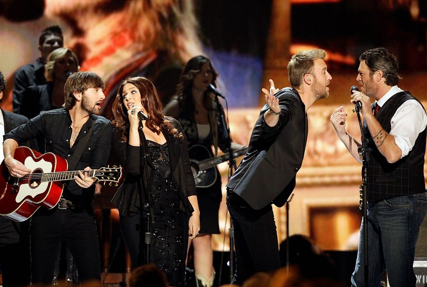 Artists, from left,  Dave Haywood, Hillary Scott, Charles Kelley and Blake Shelton perform during a tribute to Willie Nelson at the 46th Annual Country Music Awards at the Bridgestone Arena on Thursday, Nov. 1, 2012, in Nashville, Tenn. (Photo by Wade Payne/Invision/AP)