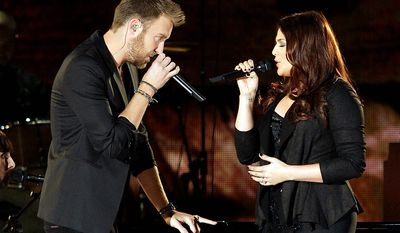 Charles Kelly, left, and Hillary Scott, of  Lady Antebellum, perform onstage at the 46th Annual Country Music Awards at the Bridgestone Arena on Thursday, Nov. 1, 2012, in Nashville, Tenn. (Photo by Wade Payne/Invision/AP)
