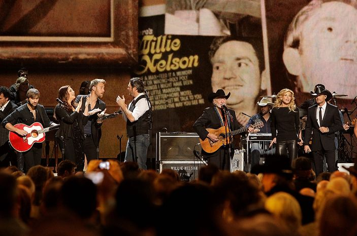 Artists, from left, from left, Dave Haywood, Hillary Scott, Charles Kelley, Blake Shelton, Willie Nelson, Faith Hill and Tim McGraw perform during a tribute to Willie Nelson at the 46th Annual Country Music Awards at the Bridgestone Arena on Thursday, Nov. 1, 2012, in Nashville, Tenn. (Photo by Wade Payne/Invision/AP)