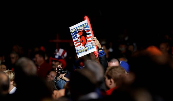 A supporter holds up a sign before Republican presidential candidate, former Massachusetts Gov. Mitt Romney takes the stage for a campaign event at Farm Bureau Live, Thursday, Nov. 1, 2012, in Virginia Beach, Va. (AP Photo/David Goldman)