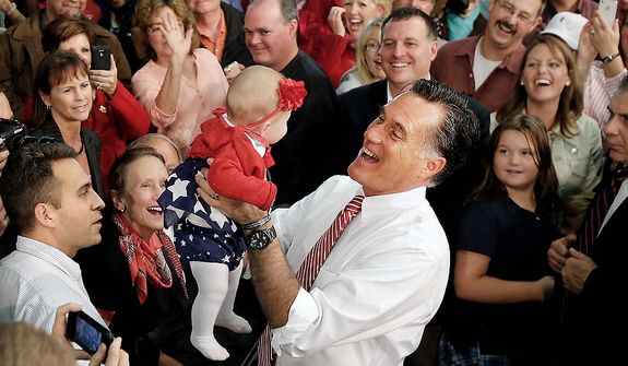 Republican presidential candidate and former Massachusetts Gov. Mitt Romney holds up 5 month-old Charlotte McGee from Maryland after speaking at the campaign event at Meadow Farm Park, Thursday, Nov. 1, 2012 in Doswell, Va. (AP Photo/ Richmond Times-Dispatch, Dean Hoffmeyer, Pool)