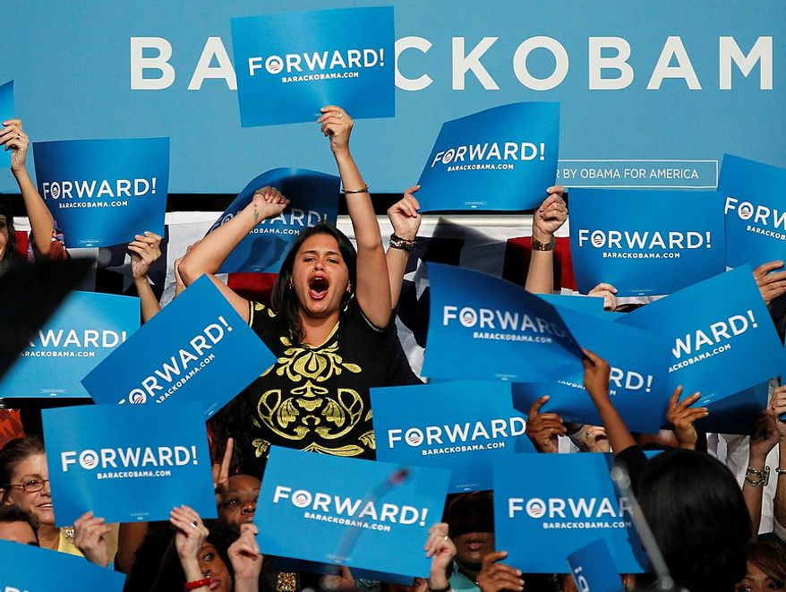 A supporter of President Barack Obama cheers before listening to first lady Michelle Obama speak at the James L. Knight Center, Thursday, Nov. 1, 2012 in Miami. (AP Photo/Wilfredo Lee)