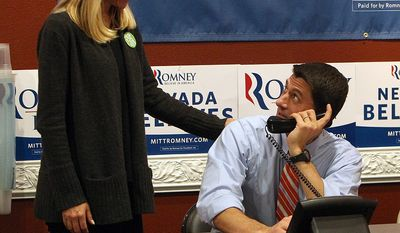 Republican vice presidential candidate Paul Ryan looks up at his wife Janna as he mans the phones at the Team Nevada headquarters in Las Vegas, Nov. 1, 2012. (AP Photo/Las Vegas Review-Journal, Jerry Henkel, Pool)