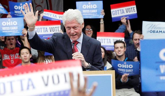 Former President Bill Clinton speaks before a crowd of supporters for the Obama-Biden ticket at an appearance at Owens Community College in Toledo, Ohio, on Thursday, Nov. 1, 2012. (AP Photo/The Blade, Amy E. Voigt)
