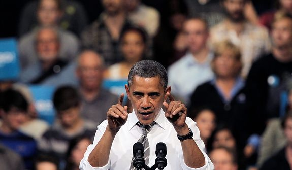 President Barack Obama gestures during a speech at campaign rally at the University of Colorado, in Boulder, Colo., Thursday, Nov. 1, 2012. (AP Photo/Brennan Linsley)