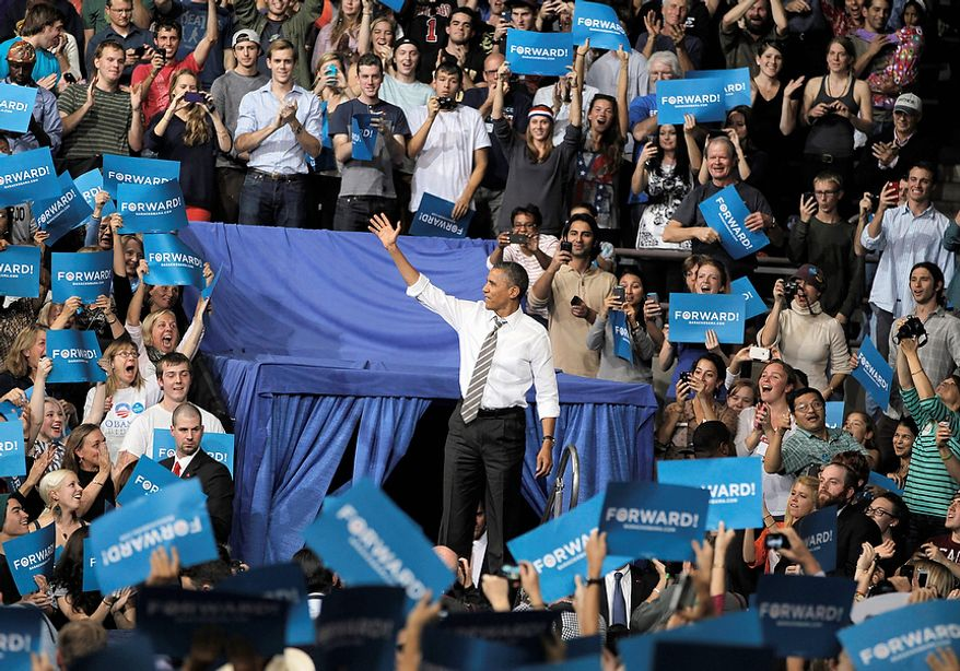 President Barack Obama waves as he arrives at a campaign rally at the University of Colorado, in Boulder, Colo., Thursday, Nov. 1, 2012.  (AP Photo/Brennan Linsley)