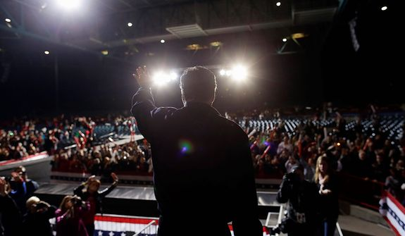 Republican presidential candidate and former Massachusetts Gov. Mitt Romney waves to the crowd as he leaves a campaign event at Farm Bureau Live at Virginia Beach, Va.,Thursday, Nov. 1, 2012. (AP Photo/Charles Dharapak)