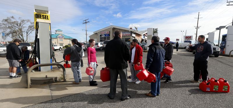A line forms at a gas pump as people wait to fill up cans on Thursday, Nov. 1, 2012, as many are left without power following Superstorm Sandy, in Toms River, N.J. Sandy, the storm that made landfall Monday, caused multiple fatalities. (AP Photo/Julio Cortez)