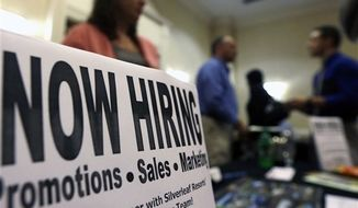 ** FILE ** In this Thursday, Oct. 25, 2012, photo, a sign attracts job-seekers during a job fair at the Marriott Hotel in Colonie, N.Y. (AP Photo/Mike Groll)