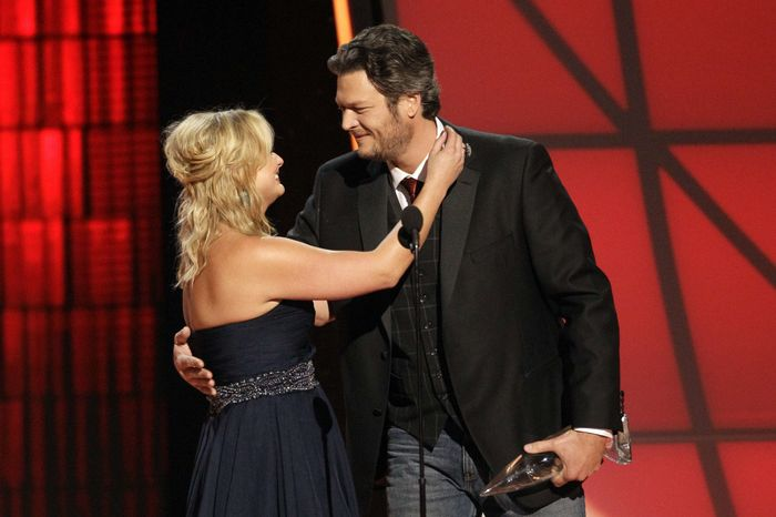 """Miranda Lambert, left, and Blake Shelton embrace onstage after winning the award for song of the year for """"Over You"""" at the 46th Annual Country Music Awards at the Bridgestone Arena on Thursday, Nov. 1, 2012, in Nashville, Tenn. (Photo by Wade Payne/Invision/AP)"""