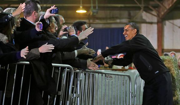 President Barack Obama greets supporters before walking on stage to speak during a campaign event at Franklin County Fairgrounds in Hilliard, Ohio, Friday, Nov. 2, 2012. (AP Photo/Pablo Martinez Monsivais)