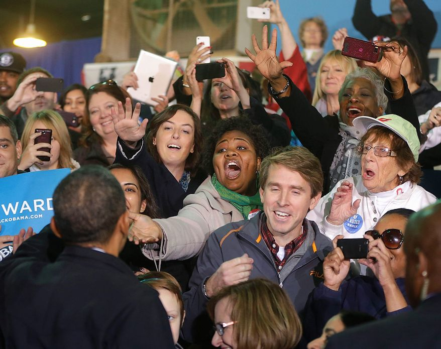 President Barack Obama greets supporters after speaking at a campaign event at Franklin County Fairgrounds in Hilliard, Ohio, Friday, Nov. 2, 2012. (AP Photo/Pablo Martinez Monsivais)