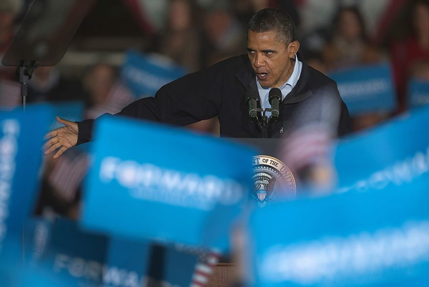 President Barack Obama gestures as he speaks at a campaign event at the Franklin County Fairgrounds, Friday, Nov. 2, 2012, in Hilliard, Ohio, before heading to another campaign stop in in Springfield, Ohio. (AP Photo/Carolyn Kaster)