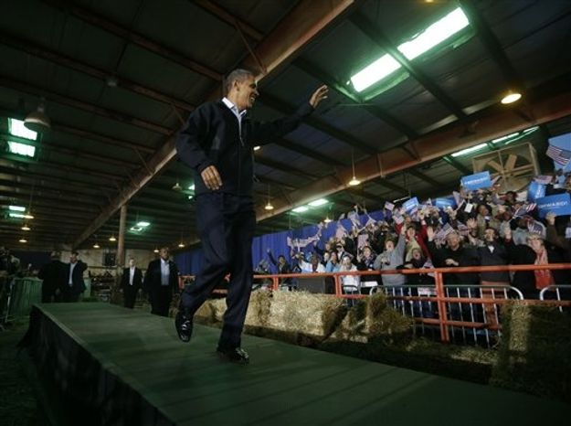 President Barack Obama waves to supporters as he is introduced before speaking at a campaign event at Franklin County Fairgrounds in Hilliard, Ohio, Friday, Nov. 2, 2012. (AP Photo/Pablo Martinez Monsivais)
