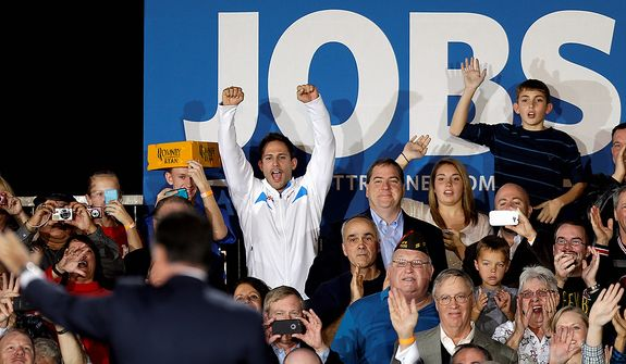 Supporters cheer as Republican presidential candidate, former Massachusetts Gov. Mitt Romney takes the stage for a campaign event at Wisconsin Products Pavilion at State Fair Park, Friday, Nov. 2, 2012, in West Allis, Wis. (AP Photo/David Goldman)