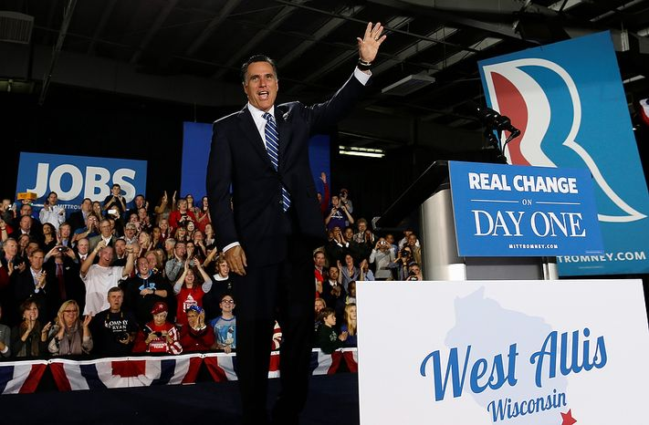 Republican presidential candidate, former Massachusetts Gov. Mitt Romney waves to supporters as he arrives for a campaign stop at the Wisconsin Products Pavilion at State Fair Park in West Allis, Wis., Friday, Nov. 2, 2012. (AP Photo/Charles Dharapak)