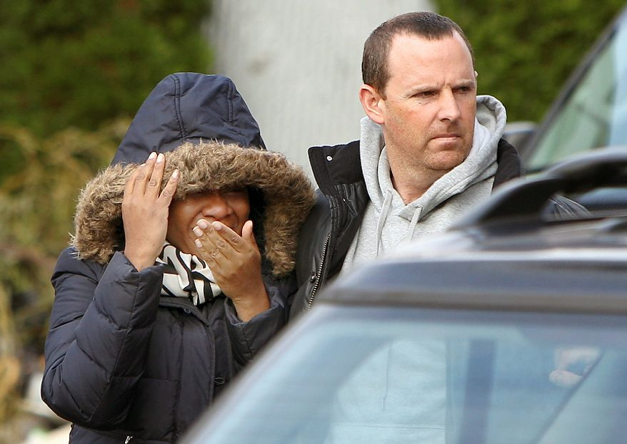 Glenda Moore, and her husband, Damian Moore, react as they approach the scene where at least one of their childrens' bodies were discovered in Staten Island, New York, Thursday, Nov. 1, 2012. Brandon Moore, 2, and Connor Moore, 4, were swiped into swirling waters as their mother tried to escape her SUV on Monday amid rushing waters that caused the vehicle to stall during Superstorm Sandy.  Police said the mother, Glenda Moore, was going to her sister's home in Brooklyn when she tried to flee the vehicle with the boys, only to have the force of the rising water and the relentless cadence of pounding waves rip the boy's small arms from her.  (AP Photo/Seth Wenig)