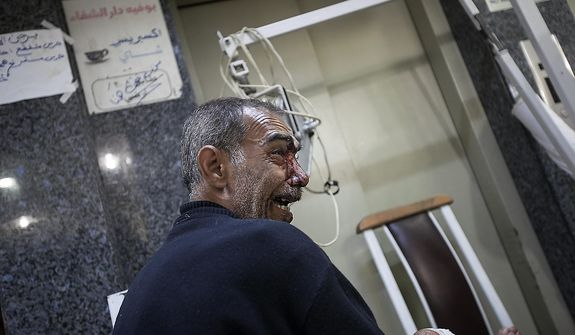 In this Wednesday, Oct. 31, 2012 photo, a shocked Syrian civilian cries after arriving to a hospital injured from an aerial attack by government forces in the Karm al-Aser neighborhood in Aleppo, Syria. Violent clashes re-ignited along the city's frontline while government warplanes attacked rebel controlled areas throughout the financial capital of Syria's largest city. (AP Photo/Narciso Contreras).