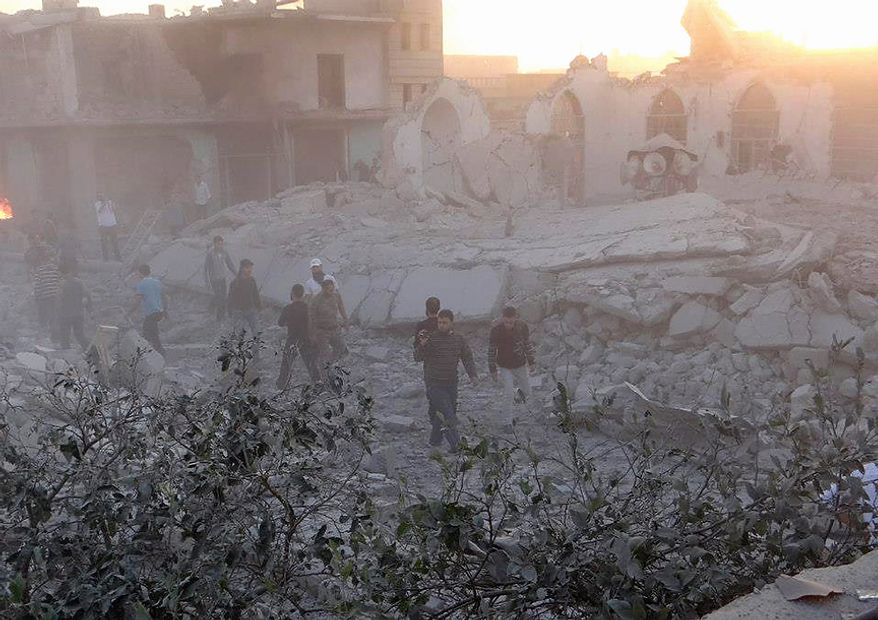 In this Thursday November 1, 2012 citizen journalism image, provided by Edlib News Network, ENN, which has been authenticated based on its contents and other AP reporting, Syrians check damaged shops and a mosque destroyed in shelling by Syrian forces loyal to Syrian President Bashar Assad, in the  village of Taftanaz, Idlib province, northern Syria. Syrian rebels killed more than 75 soldiers on Thursday, about half of them in attacks on military checkpoints in the north just hours after a wave of bombings hit the Damascus area, activists said. The unusually high toll for regime forces came after days of intense air bombardment of rebel positions around the country that killed hundreds. (AP Photo/Edlib News Network ENN)