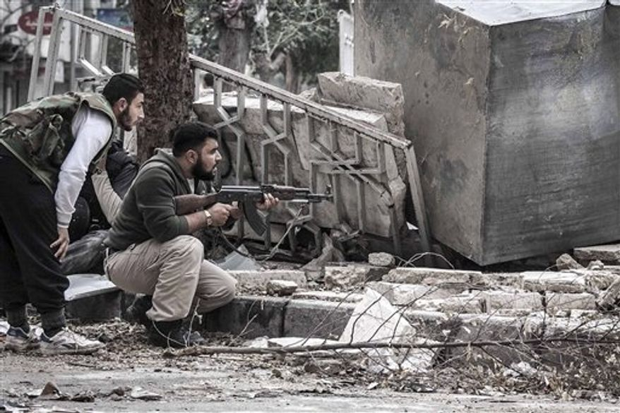 ** FILE ** In this Friday, Oct. 26, 2012, photo, Syrian rebel fighters take cover as a Syrian army sniper aims over a destroyed mosque in Tarik Al-Bab, southeast of Aleppo, Syria. (AP Photo/Narciso Contreras)