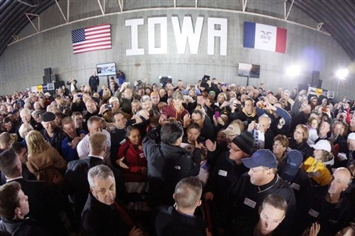 In this image made with a fisheye lens, Republican presidential candidate and former Massachusetts Gov. Mitt Romney, center, shakes hands with supporters in a hangar as he campaigns at Dubuque Regional Airport, in Dubuque, Iowa, Saturday, Nov. 3, 2012. (AP Photo/Charles Dharapak)