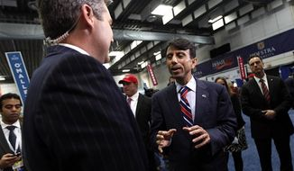** FILE ** Louisiana Gov. Bobby Jindal speaks to reporters on behalf of Mitt Romney in the spin room after the second presidential debate at Hofstra University, Tuesday, Oct. 16, 2012 Hempstead, N.Y. (AP Photo/Mary Altaffer)